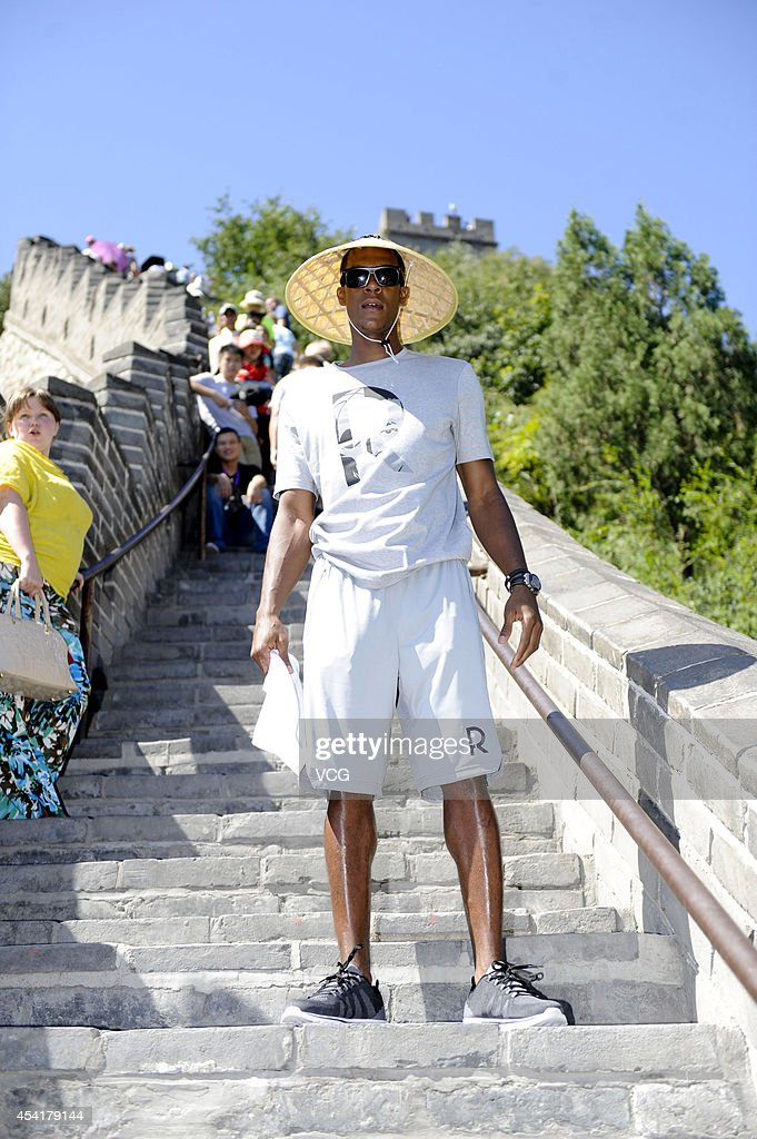 NBA player Rajon Rondo of the Boston Celtics visits the Great Wall at Juyongguan on August 26, 2014 in Beijing, China.