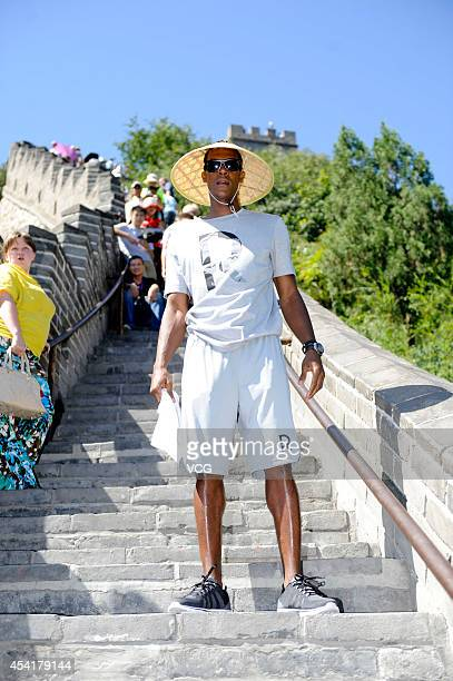 NBA player Rajon Rondo of the Boston Celtics visits the Great Wall at Juyongguan on August 26 2014 in Beijing China