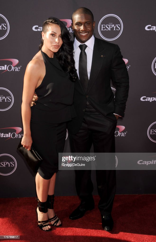 NFL player Reggie Bush and girlfriend Lilit Avagyan arrive at the 2013 ESPY Awards at Nokia Theatre L.A. Live on July 17, 2013 in Los Angeles, California.