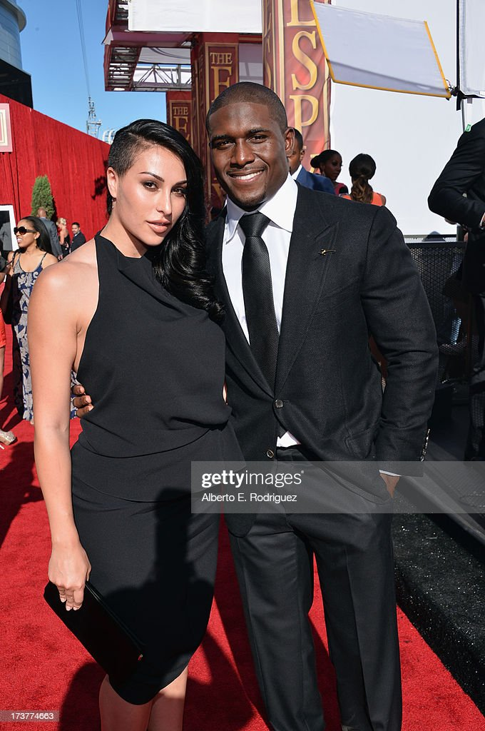 NFL player <a gi-track='captionPersonalityLinkClicked' href=/galleries/search?phrase=Reggie+Bush&family=editorial&specificpeople=183392 ng-click='$event.stopPropagation()'>Reggie Bush</a> and girlfriend Lilit Avagyan attends The 2013 ESPY Awards at Nokia Theatre L.A. Live on July 17, 2013 in Los Angeles, California.