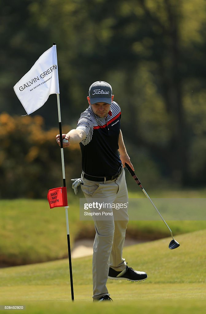 A player removes the flag during the PGA Assistants Championship East Qualifier at Ipswich Golf Club on May 5, 2016 in Ipswich, England.