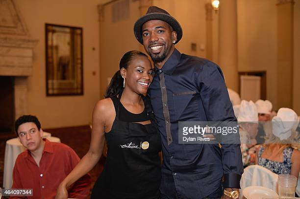 Player Richard Hamilton and guest attend the Barilla Interactive Dinner hosted by Marc Randazzo during the 2015 Food Network Cooking Channel South...