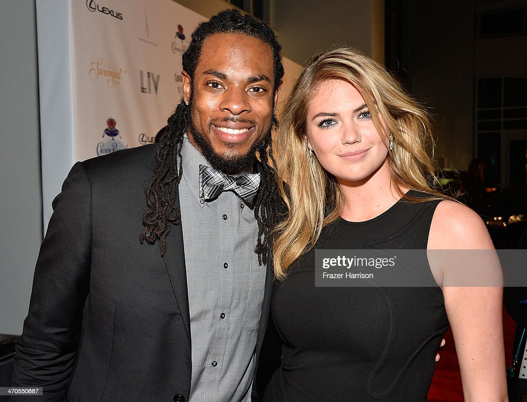 NFL player Richard Sherman and model Kate Upton attends Club SI Swimsuit at LIV Nightclub hosted by Sports Illustrated at Fontainebleau Miami on February 19, 2014 in Miami Beach, Florida.