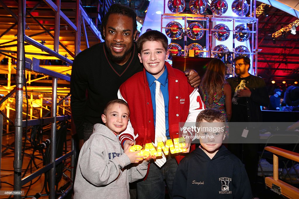 NFL player Richard Sherman of the Seattle Seahawks, Steven Accamondo, honoree Jack Wellman and Stephen Singlak attend Cartoon Network's fourth annual Hall of Game Awards at Barker Hangar on February 15, 2014 in Santa Monica, California.