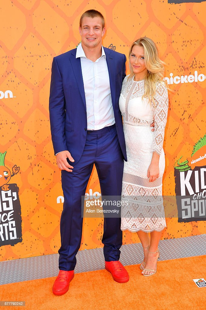 NFL player Rob Gronkowski and girlfriend Camille Kostek arrive at the Nickelodeon Kids' Choice Sports Awards 2016 at UCLA's Pauley Pavilion on July 14, 2016 in Westwood, California.