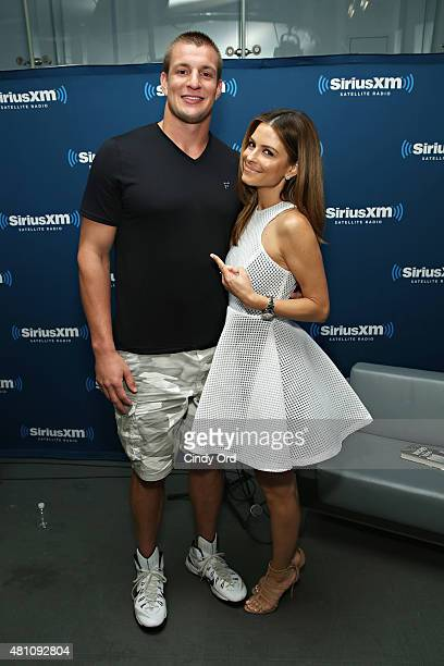 NFL player Rob Gronkowski poses for a photo with TV personality Maria Menounos during SiriusXM's 'Town Hall' with Rob Gronkowski hosted by Maria...