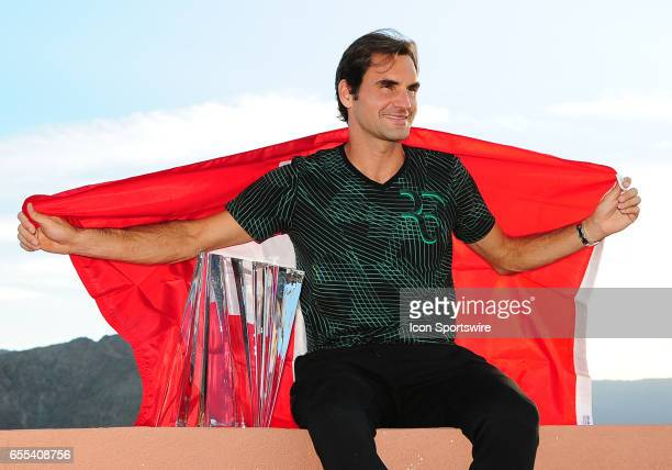 ATP player Roger Federer posses for photos with the winners trophy and the flag of Switzerland after defeating Stan Wawrinka on March 19 64 75 to...