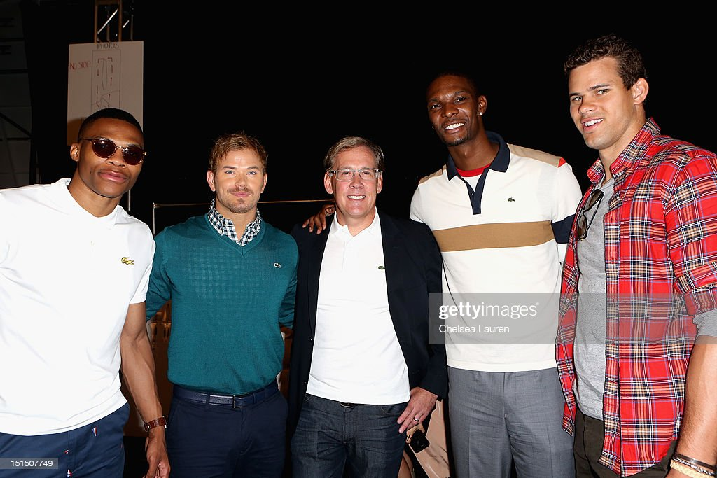 NBA player Russell Westbrook, actor Kellan Lutz, Lacoste CEO Steve Birkhold, NBA player Chris Bosh and NBA player Kris Humphries pose backstage at the Lacoste Spring 2013 fashion show during Mercedes-Benz Fashion Week at The Theatre, Lincoln Center on September 8, 2012 in New York City.