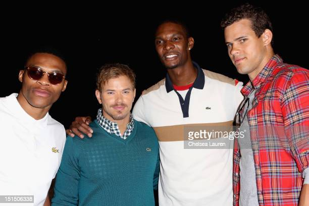 NBA player Russell Westbrook actor Kellan Lutz NBA player Chris Bosh and NBA player Kris Humphries pose backstage at the Lacoste Spring 2013 fashion...