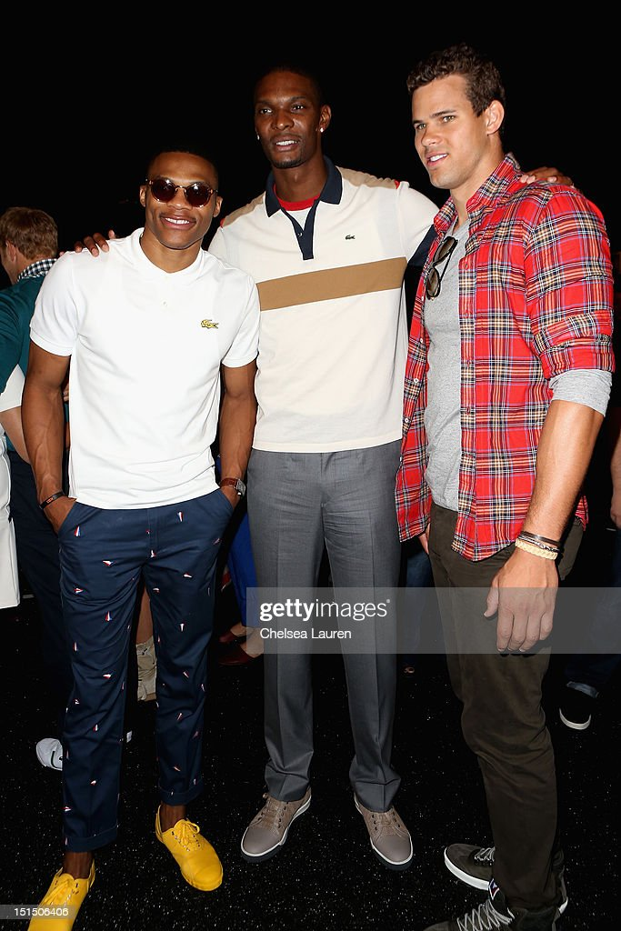 NBA player Russell Westbrook, NBA player Chris Bosh and NBA player Kris Humphries pose backstage at the Lacoste Spring 2013 fashion show during Mercedes-Benz Fashion Week at The Theatre, Lincoln Center on September 8, 2012 in New York City.