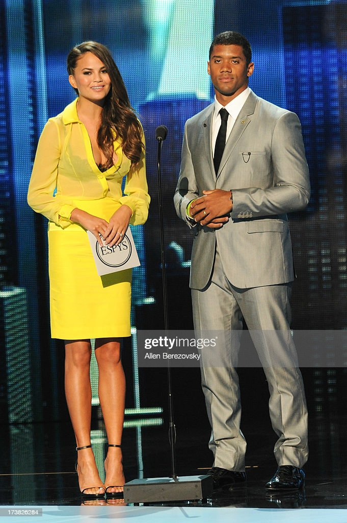 NFL player Russell Wilson and model Chrissy Teigen present award for best game onstage at the 2013 ESPY Awards at Nokia Theatre L.A. Live on July 17, 2013 in Los Angeles, California.
