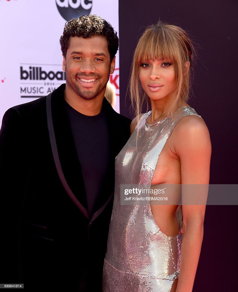 NFL player Russell Wilson and singer Ciara attend the 2016 Billboard Music Awards at TMobile Arena on May 22 2016 in Las Vegas Nevada