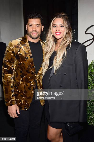 NFL player Russell Wilson and singer Ciara attend Vanity Fair and Genesis Celebrate 'Hidden Figures' on February 24 2017 in Los Angeles California