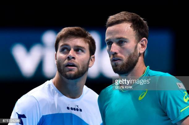 US player Ryan Harrison and New Zealand's Michael Venus talk between points against Brazil's Marcelo Melo and Poland's Lukasz Kubot during their...