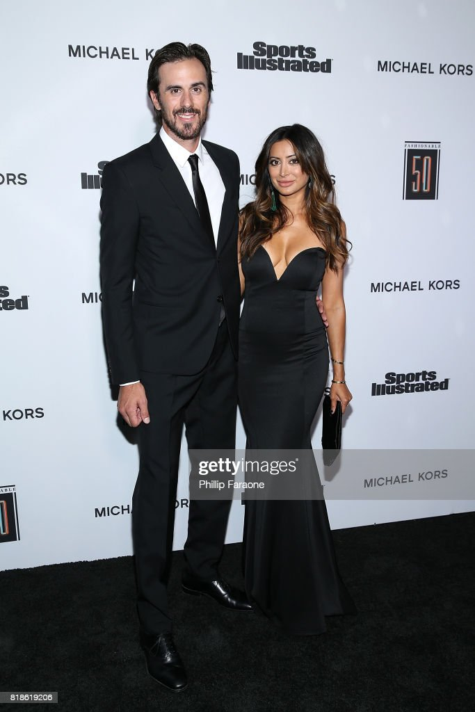 NHL player Ryan Miller (L) and actress Noureen DeWulf attend the Sports Illustrated Fashionable 50 at Avenue on July 18, 2017 in Los Angeles, California.