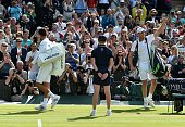US player Sam Querrey celebrates beating Serbia's Novak Djokovic during their men's singles third round match on the sixth day of the 2016 Wimbledon...