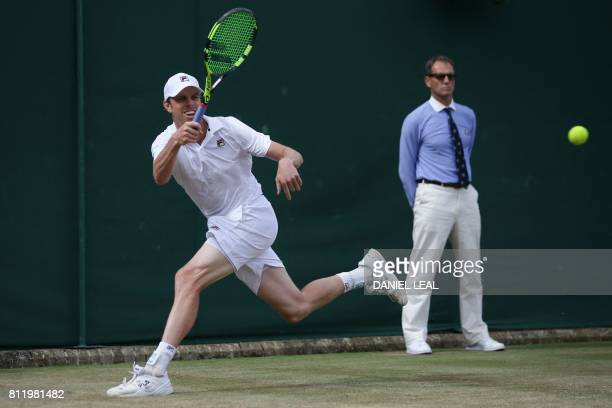 US player Sam Querrey returns against South Africa's Kevin Anderson during their men's singles fourth round match on the seventh day of the 2017...