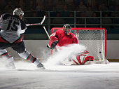 Player scoring a goal in ice hockey