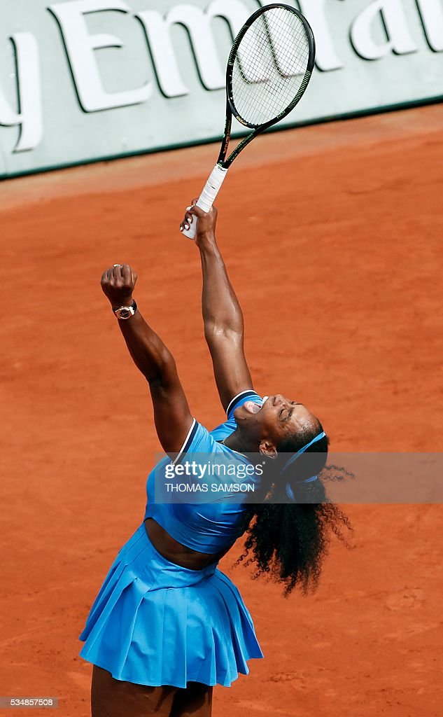 US player Serena Williams celebrates after beating France's Kristina Mladenovic during their women's third round match at the Roland Garros 2016 French Tennis Open in Paris on May 28, 2016. / AFP / Thomas SAMSON