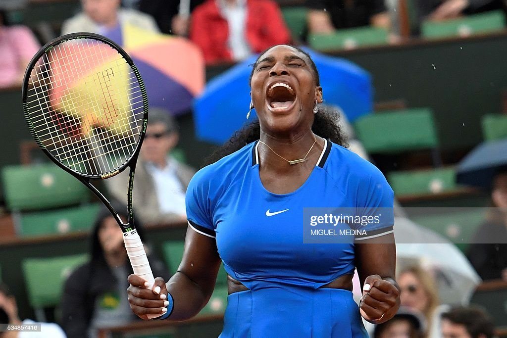 US player Serena Williams celebrates after winning a point against France's Kristina Mladenovic during their women's third round match at the Roland Garros 2016 French Tennis Open in Paris on May 28, 2016. / AFP / MIGUEL