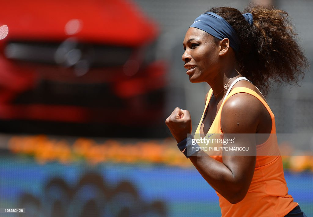 US player Serena Williams celebrates after winning a point during her women's singles third round tennis match against Russian player Maria Kirilenko at the Madrid Masters at the Magic Box (Caja Magica) sports complex in Madrid on May 9, 2013. Williams won the match 6-3, 6-1. AFP PHOTO / PIERRE-PHILIPPE MARCOU