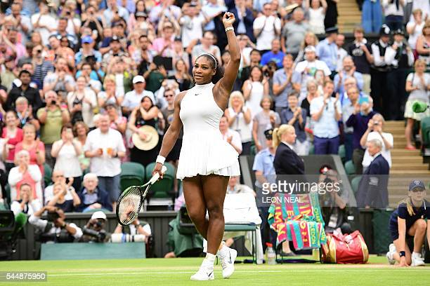 US player Serena Williams celebrates beating Russia's Svetlana Kuznetsova during their women's singles fourth round match on the eighth day of the...