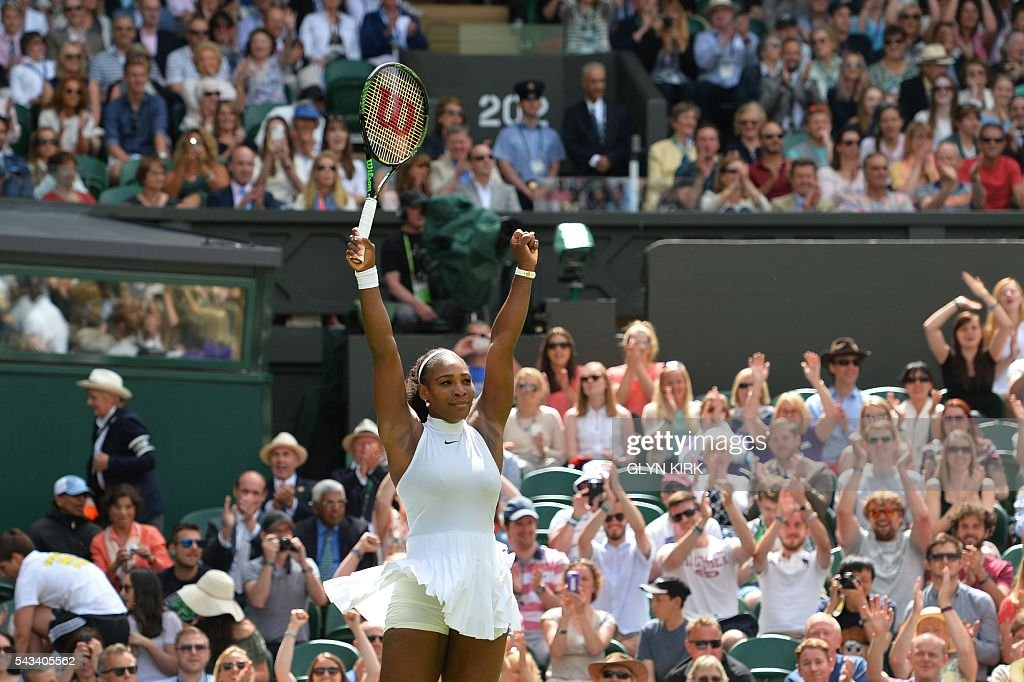 US player Serena Williams celebrates beating Switzerland's Amra Sadikovic during their women's singles first round match on the second day of the 2016 Wimbledon Championships at The All England Lawn Tennis Club in Wimbledon, southwest London, on June 28, 2016. / AFP / GLYN