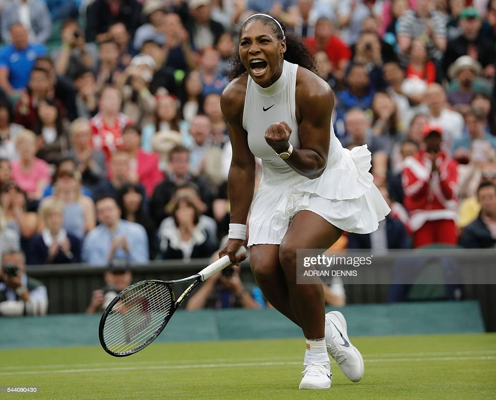 US player Serena Williams celebrates beating US player Christina McHale during their women's singles second round match on the fifth day of the 2016 Wimbledon Championships at The All England Lawn Tennis Club in Wimbledon, southwest London, on July 1, 2016. / AFP / ADRIAN