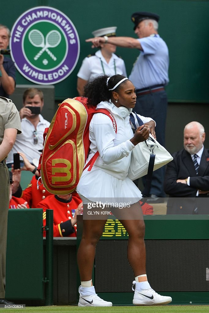 US player Serena Williams comes onto Centre Court to play against Switzerland's Amra Sadikovic during their women's singles first round match on the second day of the 2016 Wimbledon Championships at The All England Lawn Tennis Club in Wimbledon, southwest London, on June 28, 2016. / AFP / GLYN