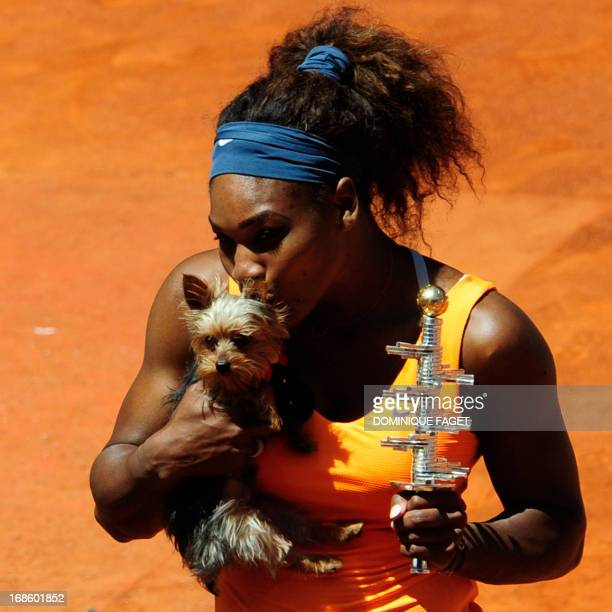 US player Serena Williams holds the trophy and her dog after winning the women's singles final tennis match of the Madrid Masters against Russian...