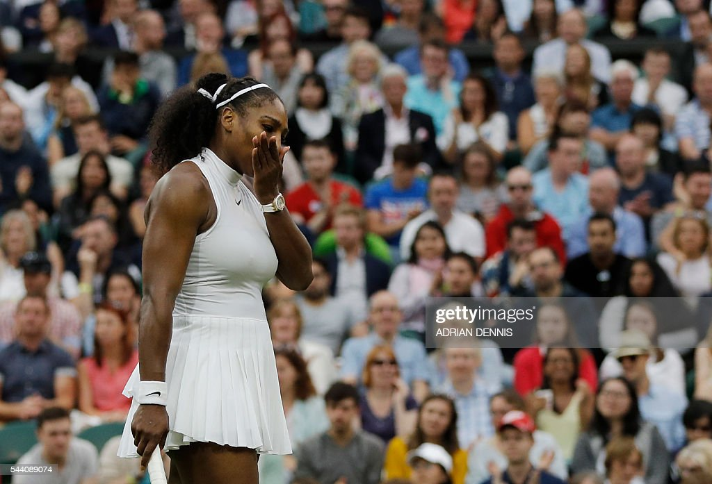 US player Serena Williams loses a point to US player Christina McHale during their women's singles second round match on the fifth day of the 2016 Wimbledon Championships at The All England Lawn Tennis Club in Wimbledon, southwest London, on July 1, 2016. / AFP / ADRIAN