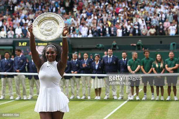 US player Serena Williams poses with the winner's trophy the Venus Rosewater Dish after her women's singles final victory over Germany's Angelique...