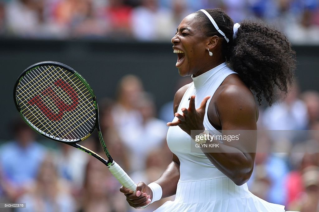US player Serena Williams reacts after a point against Switzerland's Amra Sadikovic during their women's singles first round match on the second day of the 2016 Wimbledon Championships at The All England Lawn Tennis Club in Wimbledon, southwest London, on June 28, 2016. / AFP / GLYN