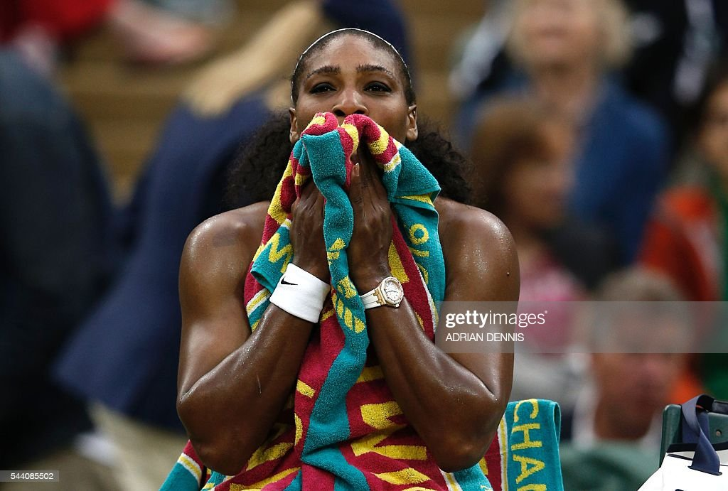 US player Serena Williams reacts after losing the first set to US player Christina McHale during their women's singles second round match on the fifth day of the 2016 Wimbledon Championships at The All England Lawn Tennis Club in Wimbledon, southwest London, on July 1, 2016. / AFP / ADRIAN