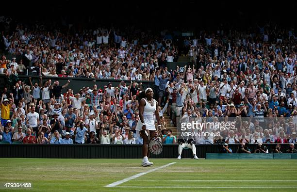 US player Serena Williams reacts as the crowd cheers for Britain's Heather Watson during their women's singles third round match on day five of the...