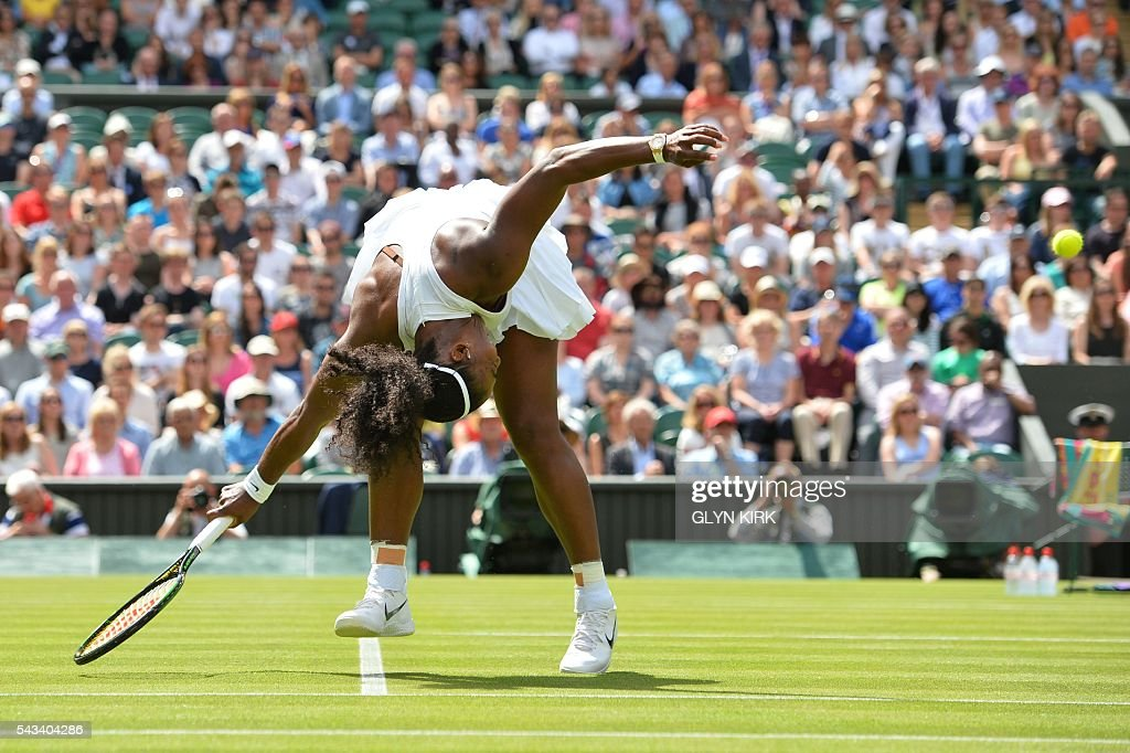 US player Serena Williams returns against Switzerland's Amra Sadikovic during their women's singles first round match on the second day of the 2016 Wimbledon Championships at The All England Lawn Tennis Club in Wimbledon, southwest London, on June 28, 2016. / AFP / GLYN