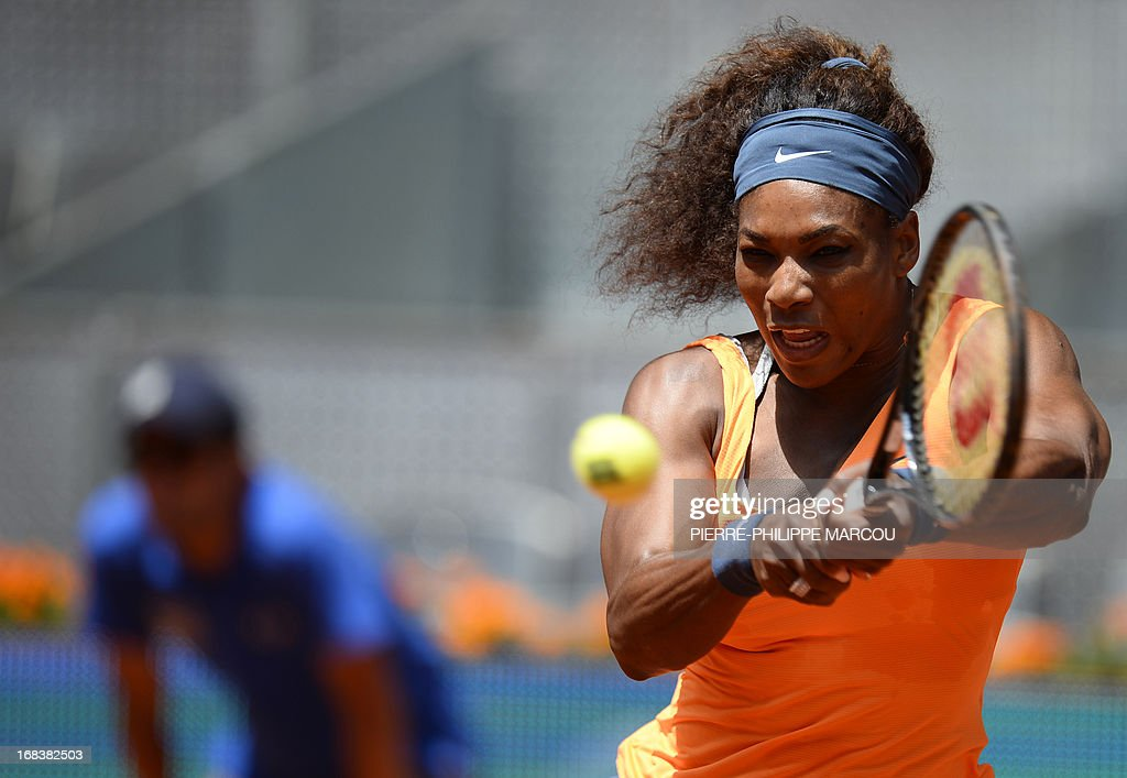 US player Serena Williams returns the ball to Russian player Maria Kirilenko during their women's singles third round tennis match at the Madrid Masters at the Magic Box (Caja Magica) sports complex in Madrid on May 9, 2013. Williams won the match 6-3, 6-1. AFP PHOTO / PIERRE-PHILIPPE MARCOU