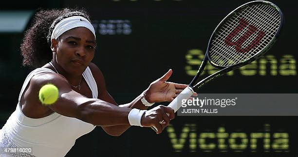 US player Serena Williams returns to Belarus's Victoria Azarenka during their women's quarterfinals match on day eight of the 2015 Wimbledon...