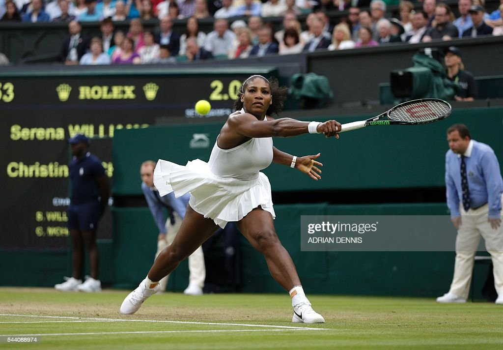 US player Serena Williams returns to US player Christina McHale during their women's singles second round match on the fifth day of the 2016 Wimbledon Championships at The All England Lawn Tennis Club in Wimbledon, southwest London, on July 1, 2016. / AFP / ADRIAN