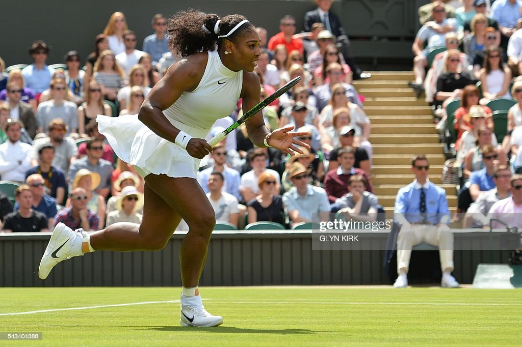 US player Serena Williams runs in to reach a return against Switzerland's Amra Sadikovic during their women's singles first round match on the second day of the 2016 Wimbledon Championships at The All England Lawn Tennis Club in Wimbledon, southwest London, on June 28, 2016. / AFP / GLYN