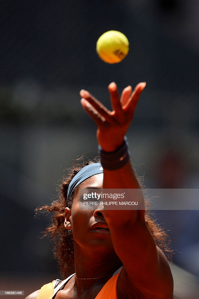 US player Serena Williams serves against Russian player Maria Kirilenko during their women's singles third round tennis match at the Madrid Masters at the Magic Box (Caja Magica) sports complex in Madrid on May 9, 2013. Williams won the match 6-3, 6-1.