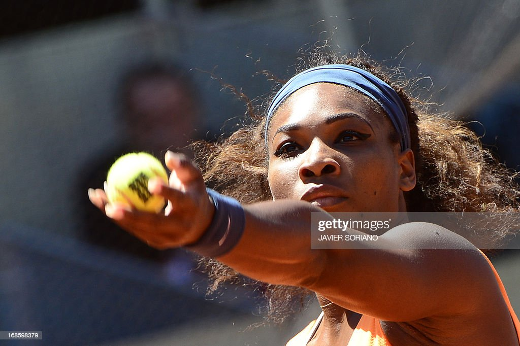 US player Serena Williams serves against Russian player Maria Sharapova during their women's singles final tennis match at the Madrid Masters at the Magic Box (Caja Magica) sports complex in Madrid on May 12, 2013.