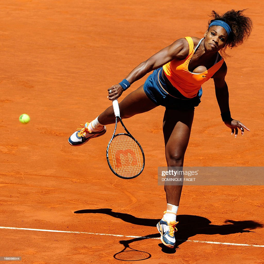 US player Serena Williams serves against Russian player Maria Sharapova during their women's singles final tennis match at the Madrid Masters at the Magic Box (Caja Magica) sports complex in Madrid on May 12, 2013. AFP PHOTO / DOMINIQUE FAGET