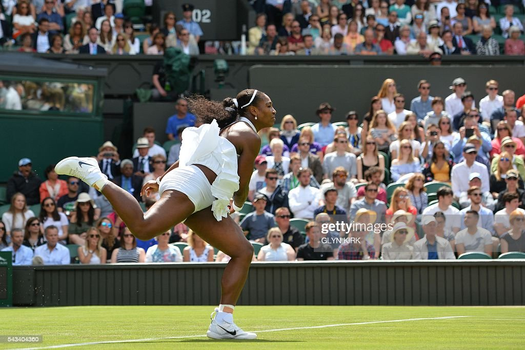 US player Serena Williams serves against Switzerland's Amra Sadikovic during their women's singles first round match on the second day of the 2016 Wimbledon Championships at The All England Lawn Tennis Club in Wimbledon, southwest London, on June 28, 2016. / AFP / GLYN