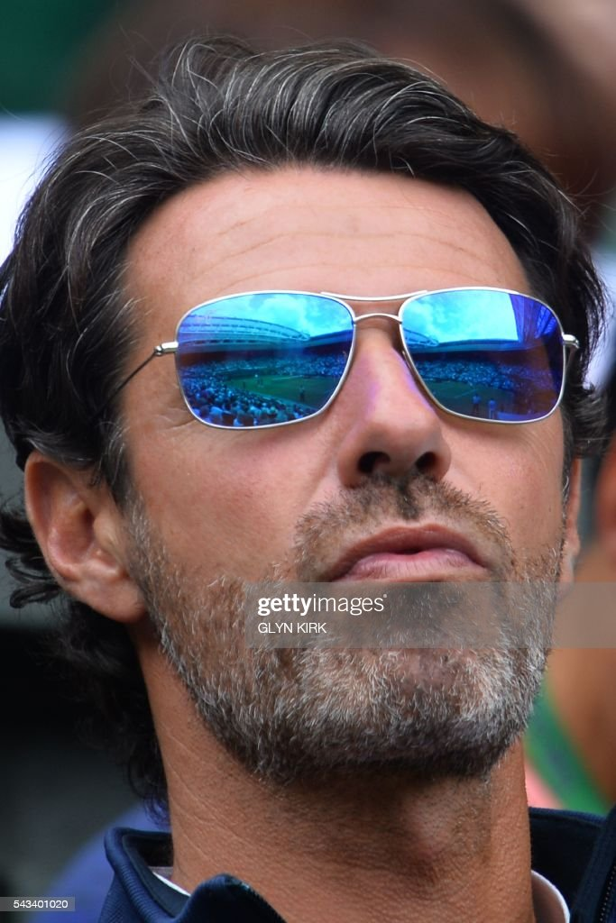 US player Serena Williams's coach Patrick Mouratoglou watches Williams on Centre Court play against Switzerland's Amra Sadikovic during their women's singles first round match on the second day of the 2016 Wimbledon Championships at The All England Lawn Tennis Club in Wimbledon, southwest London, on June 28, 2016. / AFP / GLYN