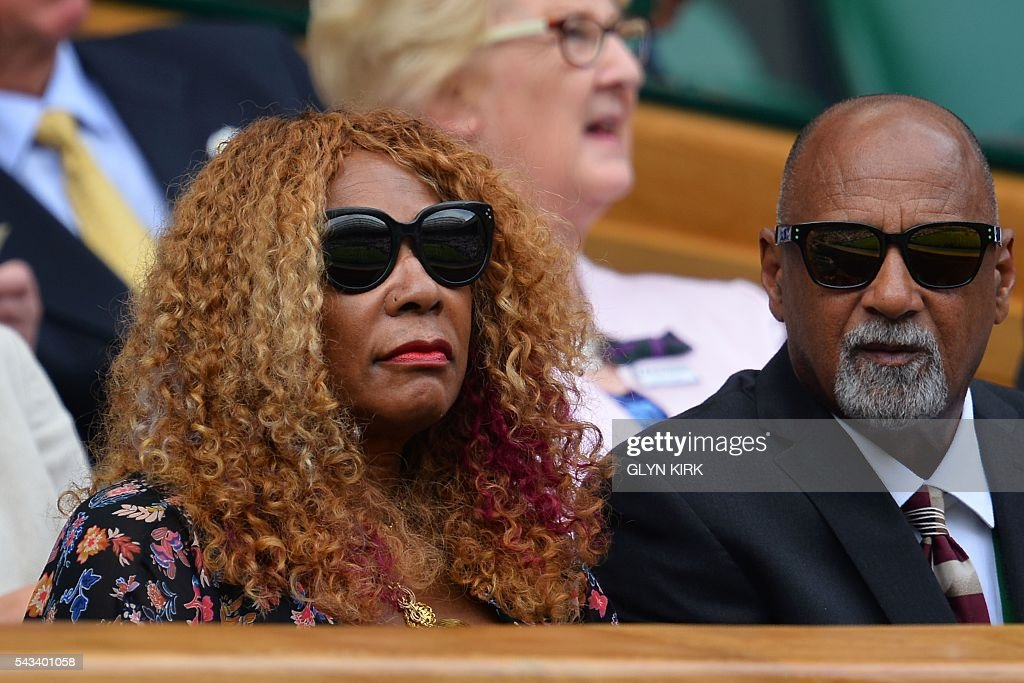 US player Serena Williams's mother Oracene Price (L) sits in the royal box to watch Serena on Centre Court play against Switzerland's Amra Sadikovic during their women's singles first round match on the second day of the 2016 Wimbledon Championships at The All England Lawn Tennis Club in Wimbledon, southwest London, on June 28, 2016. / AFP / GLYN