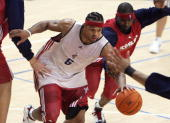 NBA player Shannon Brown of the Cleveland Cavaliers is chased by teammate Larry Hughes during a training session before their 17 October exhibition...