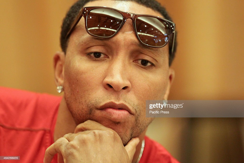 NBA player Shawn Marion gestures while answering questions...