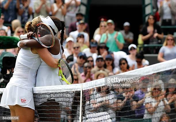 US player Sloane Stephens hugs Russia's Svetlana Kuznetsova after winning their women's singles third round match on the seventh day of the 2016...