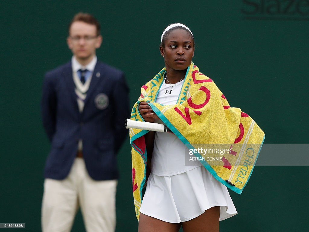 US player Sloane Stephens walks from the court after rain stops play during her women's singles first round match against China's Peng Shuai on the third day of the 2016 Wimbledon Championships at The All England Lawn Tennis Club in Wimbledon, southwest London, on June 29, 2016. / AFP / ADRIAN